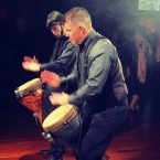 A great way to get people on the dance floor is with this choreographed dueling bongo act.